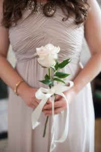 03 Single Stem Bouquets Are Perfect For Bridesmaids Like This White Rose With A Ribbon Bow
