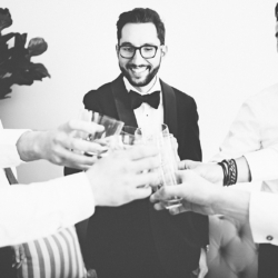 Groom toast with groomsmen before his wedding coordinated by Magnificent Moments Weddings