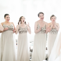 Bridesmaids wearing sequin and cream dresses react to brides dress