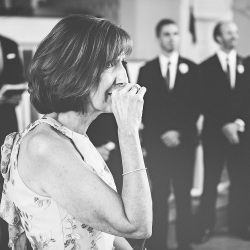 Mother of the bride reaction to daughter walking down the aisle captured by Cheyenne Schultz Photography