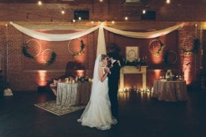 Couples first dance in 10 Catawba's ballroom with design by Blooming Branch Creative