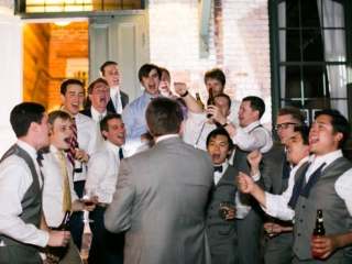 Fraternity brothers singing their wedding song