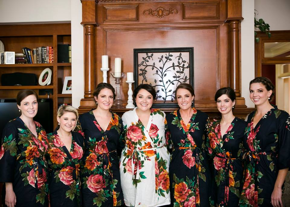 Bride and bridesmaids getting ready in robes.
