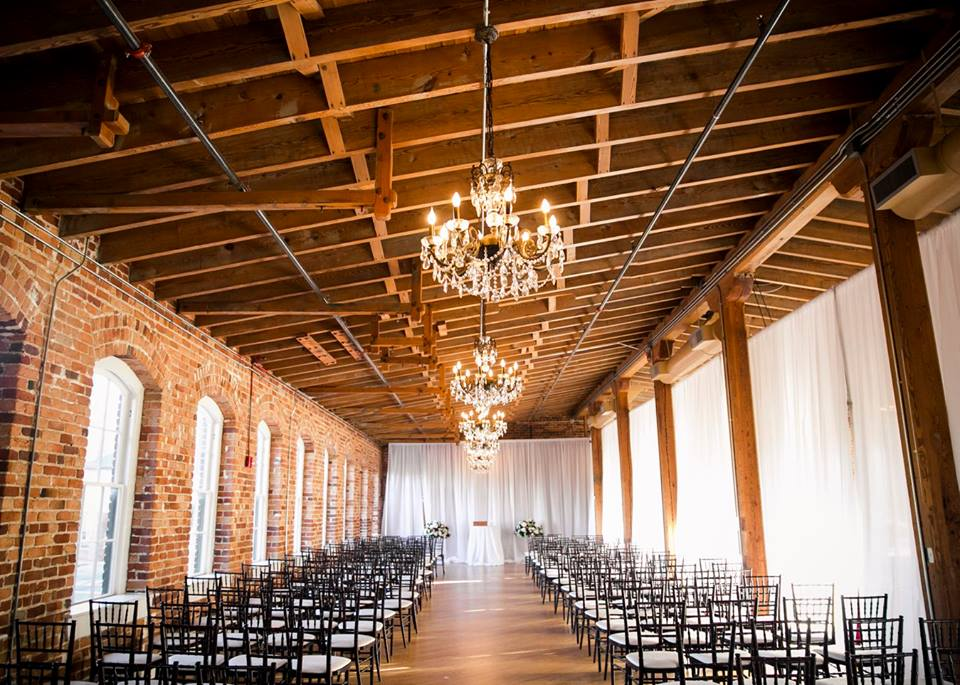 Magnificent Moments Weddings ceremony setup at Melrose Knitting Mill