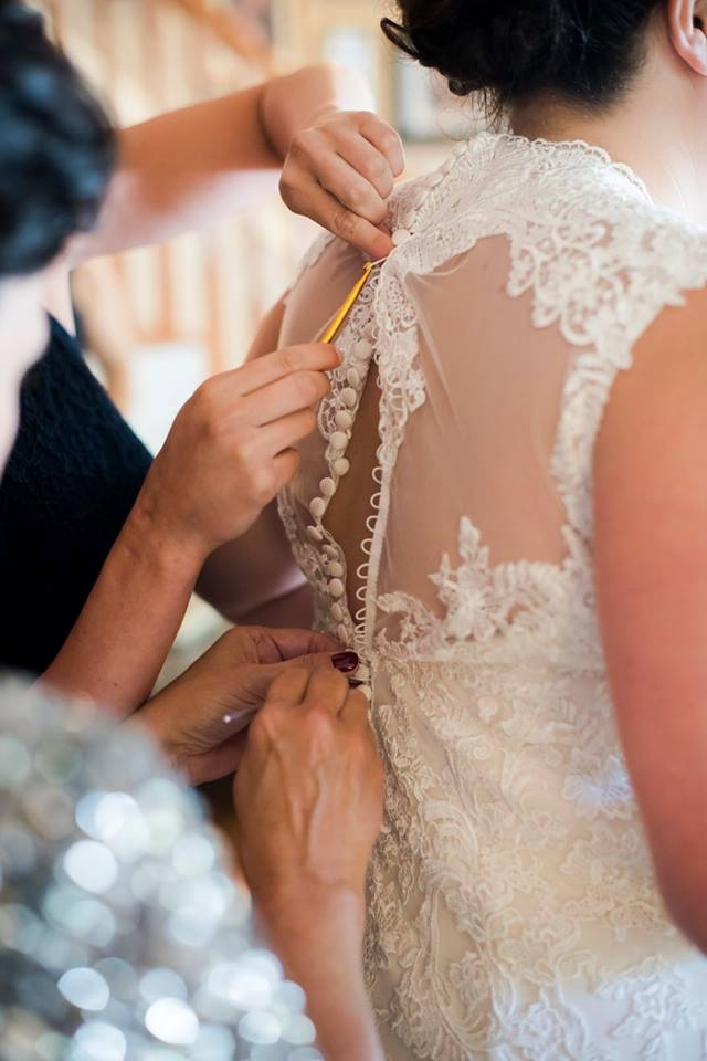 loom and hook for the bride's buttons on the back of her dress