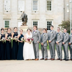 Bridal Party in downtown Raleigh. Girls in navy dresses, guys in gray suits and bow ties.