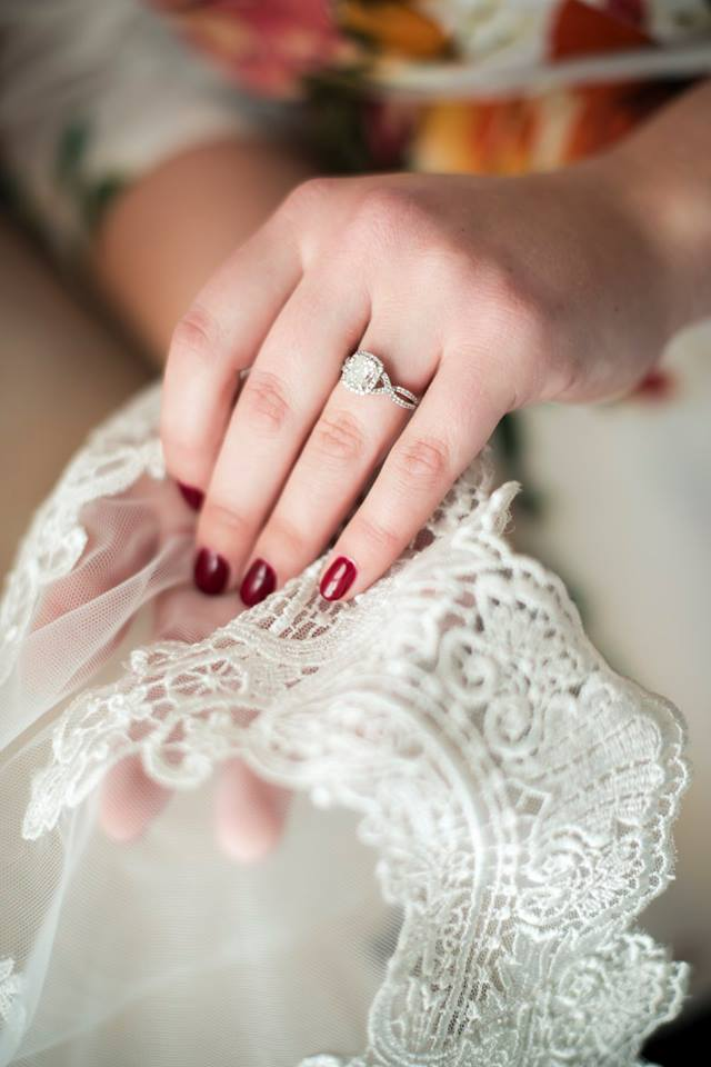 bride holding the bottom of her lace veil