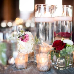 votive candles with centerpieces for a wedding