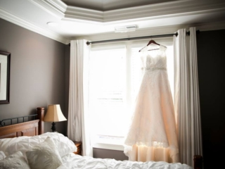 Bridal gown hanging up in window