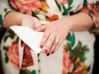 Bride holding her Chi Omega handkerchief