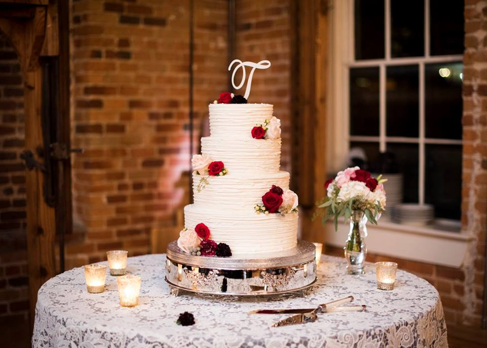 Magnificent Moments Weddings lace cake table CE Rental linen with gorgeous cake.