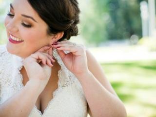 Bride putting on her earrings