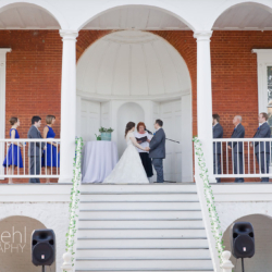 Gorgeous wedding ceremony on the porch of the Robert Mills House in Columbia, SC.
