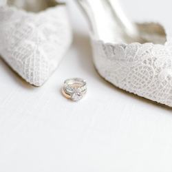 Alyssa Frost Photography captures a stunning detail shot of bridal rings and shoes for a summer wedding at Firethorne Country Club