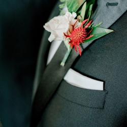 Grooms boutonniere features a pop of red for a summer wedding at Firethorne Country Club just outside of Charlotte, North Carolina