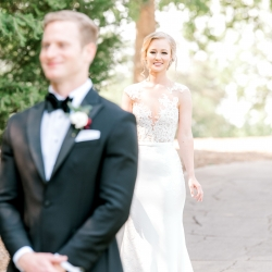 Bride is all smiles as she approaches her groom in a first look at Firethorne Country Club