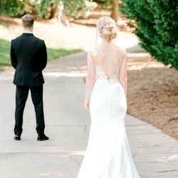 Alyssa Frost Photography captures a bride approaching her groom for a first look