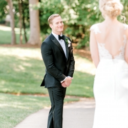 Alyssa Frost Photography captures a smiling groom as he sees his bride during a heartfelt first look before their wedding ceremony at Firethorne Country Club