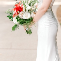 Stunning bridal bouquet features soft whites with a bold red accents created by Lily Bee's Floral for a summer wedding at Firethorne Country Club
