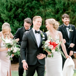 Bride and groom share a laugh with their bridal party as they prepare for their summer wedding captured by Alyssa Frost Photography