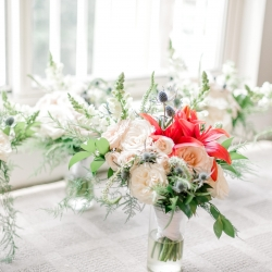 Stunning bouquets created by Lily Bee's Floral were the perfect accent to a summer wedding at Firethorne Country Club