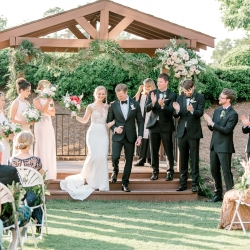 Bride and groom exit their ceremony as husband and wife captured by Alyssa Frost Photography