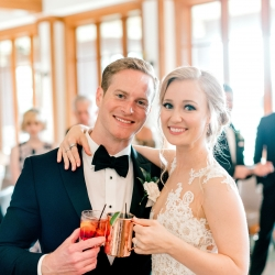 Bride and groom show off their signature cocktails created for their summer wedding at Firethorne Country Club