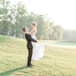 Bride and groom share a sweet moment during their first look captured by Alyssa Frost Photography during their summer wedding reception at Firethorne Country Club