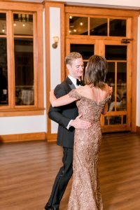 Groom shares a dance with his mother during a wedding reception coordinated by Magnificent Moments Weddings and captured by Alyssa Frost Photography