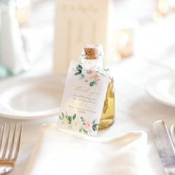 Rosemary infused olive oil created by the brides mother served as a touch favor to guests during a summer wedding coordinated by Magnificent Moments Weddings