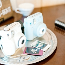 Polariod camera served as a fun guestbook that allowed guest to share sweet moments from the night with the bride and groom