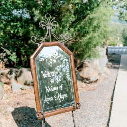 Sweet welcome sign greets guests as the enter a fall ceremony at Stony Mountain Vineyards coordinated by Magnificent Moments Weddings