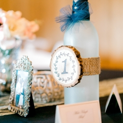 Wine bottles serve as table numbers at a fall wedding at Stony Mountain Vineyards coordinated by Magnificent Moments Weddings