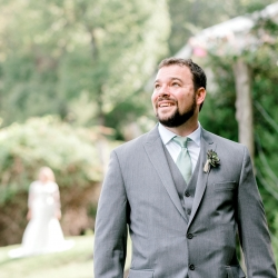 Groom waits anxiously for his bride and their first look captured by Alyssa Frost Photography