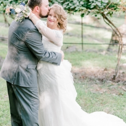Alyssa Frost Photography captures a bride and groom among the vineyards during their fall wedding at Stony Mountain Vineyards