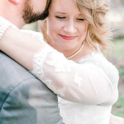 Bride and groom share a sweet moment together after their first look captured by Alyssa Frost Photography