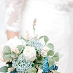 Detail shot of a stunning bridal bouquet full of soft blue flowers captured by Alyssa Frost Photography