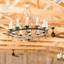 Beautiful chandeliers at Stony Mountain Vineyards create an elegant atmosphere for an early fall wedding