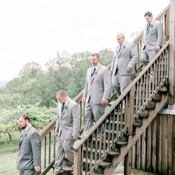 Groom and groomsmen enter for his ceremony located at a scenic vineyard in the Mountains of North Carolina
