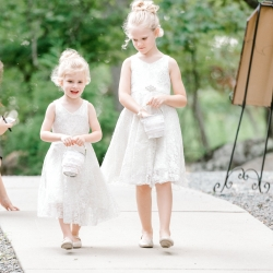Sweet flower girls line the aisle for the bride at a fall ceremony at Stony Mountain Vineyards captured by Alyssa Frost Photography