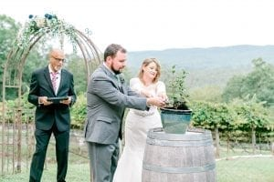 Bride and groom plant a family tree and solidify their roots during their fall ceremony at Stony Mountain Vineyards