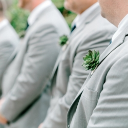 Detail shot of groomsmen succulent boutineers