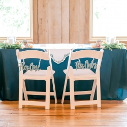 Sweetheart chairs with couples messages at a Stony Mountain Vineyard
