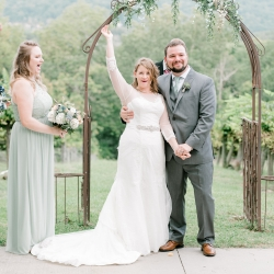 Bride celebrates after her vows at Stony Mountain Vineyards coordinated by Magnificent Moments Weddings