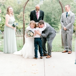 Bride and groom share a sweet hug with their son during their mountain top wedding at Stony Mountain Vineyards captured by Alyssa Frost Photography