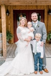 Sweet family picture of the bride and groom with their children before their fall wedding at Stony Mountain Vineyards