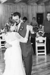 Bride and groom share their first dance played by High Impact Entertainment during their fall wedding at Stony Mountain Vineyards