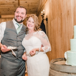 Bride and groom cut their Wow Factor Cake during their fall wedding reception at Stony Mountain Vineyards captured by Alyssa Frost Photography