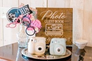 Photo guestbook allowed for guests to take photobooth style pictures during a fall wedding at Stony Mountain Vineyards