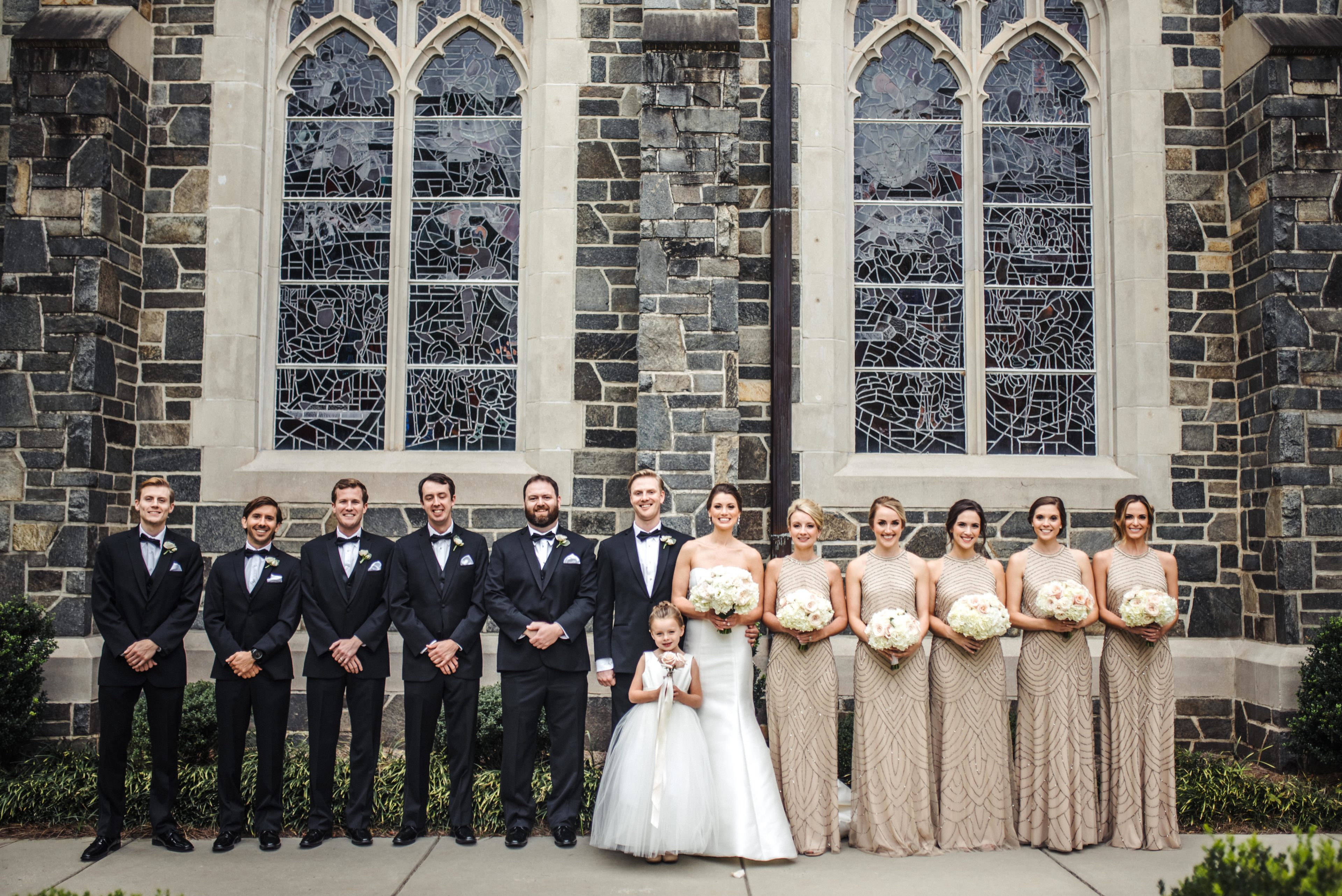 Bridal Party photo shwoing groomsmen and bridesmaids wearing stunning gold bridesmaids dresses with sequin accent